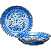 Pair of Japanese blue and white small saucers with scalloped edges and Chinese Chenghua reign marks circa 18th
