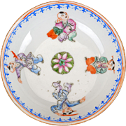 Chinese over glaze enamel porcelain saucer with four boys 19th century