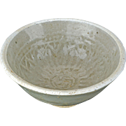 Chinese Song dynasty small tea bowl with a carved design circa 13th century