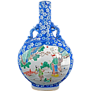 Famille rose moon flask with blue and white ground and a poly-chrome panels late Qing Dynasty 19th C