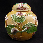 Polychrome enameled porcelain covered jar with egret and lotus c 1900