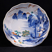 Late Edo (1820-1860) Japanese porcelain Imari bowl of waterfall and mountain scene