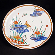 Japanese porcelain Meiji era (1868-1912) deep plate with crane amongst Iris in stylized rippled pond