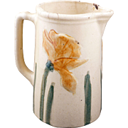 Antique yelloware pitcher with Daffodil motif late 19th century