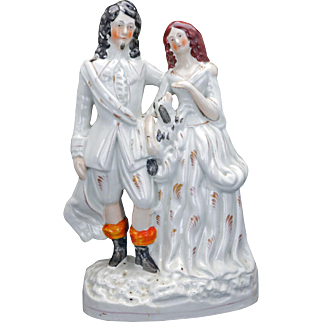 Large Staffordshire ceramic figure of a gentleman, his wife and pet dog 19th century