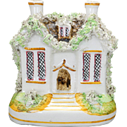 Antique Victorian Staffordshire moneybox bank in the form of a cottage c 1910