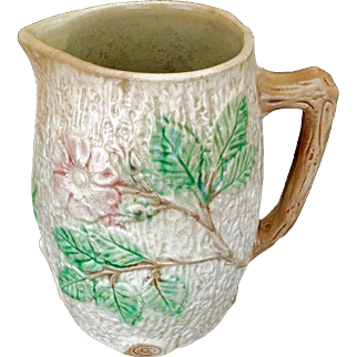 Ceramic majolica pitcher with apple blossom design early 20th C