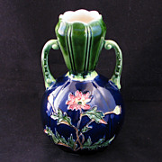 Majolica vase early 20th century with incised floral design and handles