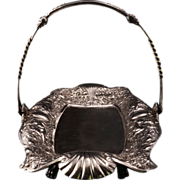 Victorian silver plate cake basket with cupids by Reed and Barton circa 1880