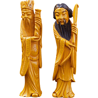 Pair of early Chinese Bakelite resin figures of immortals circa 1920