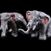 Pair of cast metal black colored elephants circa 1930