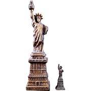 Pair of Statue of Liberty metal souvenirs early 20th century