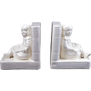 Figural ceramic bookends of children reading made in Japan circa 1930