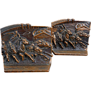 Chariot Rounding the Bend iron bookends with copper patina circa 1930