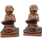 First Lessons, heavy bronze clad gray metal bookends circa 1920