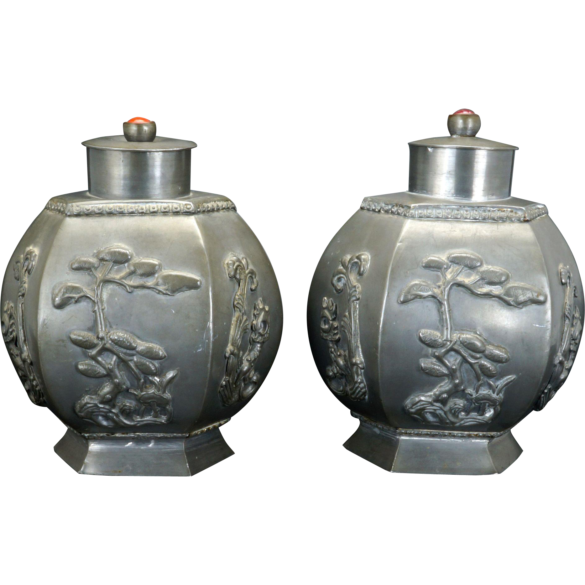 Matched pair of Chinese metal tea caddies with molded auspicious symbols and carnelian beads circa 1900