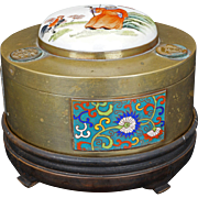 Chinese brass lidded box with cloisonné and porcelain finial and wood stand early 20th century