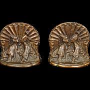 Siam Couple heavy cast iron bookends with copper finish circa 1926