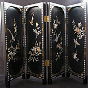 Four panel lacquer and mother of pearl Chinese folding table screen