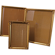 Set of three ornate vintage gold tone metal picture frames