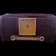 Vintage 1950s Mid-century dark brown General Electric Tube Clock Radio Model 572