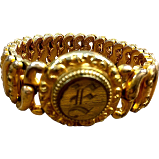 "The American Queen expandable gold plated bracelet ""E"" patented 1907"
