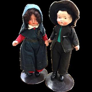 Pair of Amish stone bisque dolls