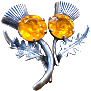 Silver Thistle pin amber colored rhinestones