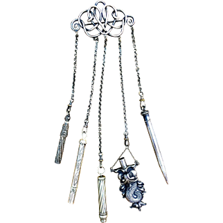 Silver chatelaine with serpent included in five appendages
