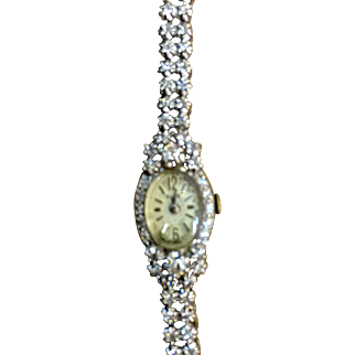 14 Karat white gold marked diamond watch 1960's
