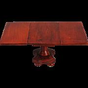 Drop-leaf Center-pedestal Dining Table