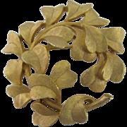Crown Trifari gold-tone wreath leaf brooch