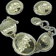 Elizabeth Taylor for AVON gold tone E bracelet and earrings