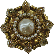 Vintage Miriam Haskel Gold tone brooch with large faux pearl
