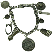 Sterling Silver charm bracelet with Sombrero, sandal, cup, pitcher, rope, Gold panning dish, Medallion and more