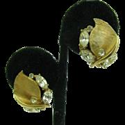 BSK gold tone clip earrings
