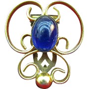 Beautiful Dress clip with large oval blue stone