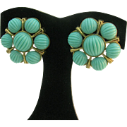 Crown Trifari clip earrings with turquoise colored melon glass cabochons