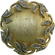 Trifari Gold tone domed circle brooch with leaves