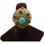 Signed ART Poison ring with blue cabochon center stone