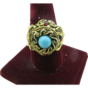 Signed ART Poison Ring with blue Cabochon and red rhinestones