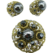 West Germany Pin and earrings set Hematite glass and enameled