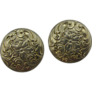 Napier gold tone clip earrings with flower design