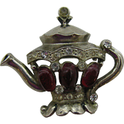 Silver tone tea pot pin with oval red cabochons