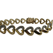 Very pretty Heart bracelet done in sterling and gold plated