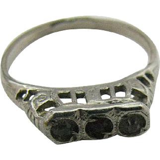 Tiny size 2 baby ring in silver tone metal with two faux diamonds and one faux ruby