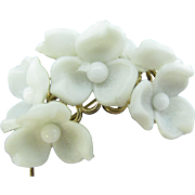 Sweet little Napier brooch with plastic flowers