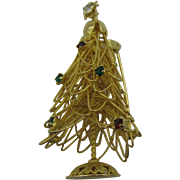 Woven Christmas tree pin with red and green rhinestones