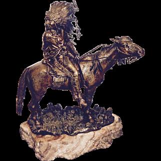 Carl Kauba patinated bronze Indian on horseback