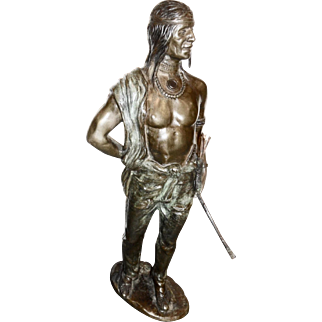 Cal Kauba  Patinated bronze of standing Indian w/ bow   signed in the bronze